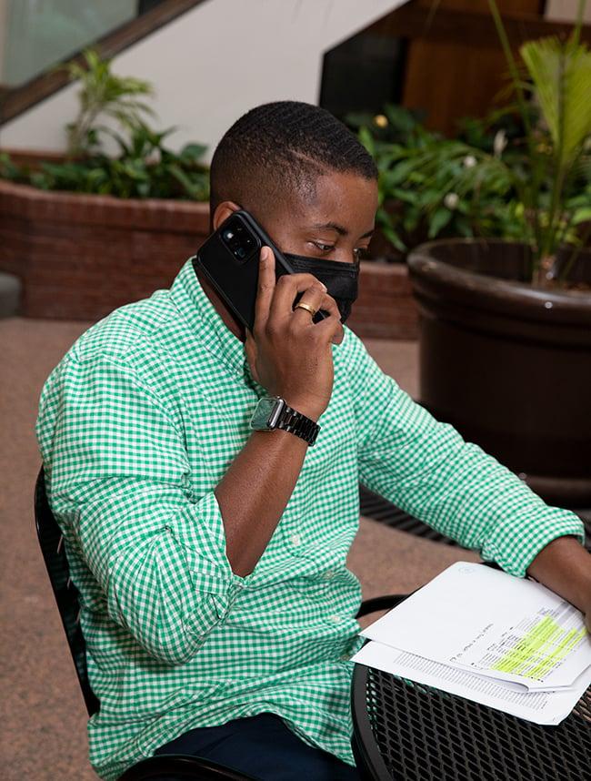 davartay-phone-with-paperwork